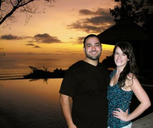 Michael Aliberte and Callie Walsh outside their home in Costa Rica with a view of the sunset on the Pacific Ocean