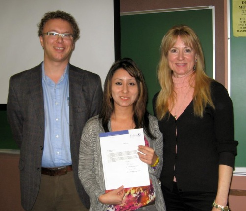 Rosario Barzola receiving her award from Professors Reeds and Doll