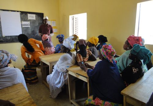 Women in the classroom learning about seeds and planting techniques.