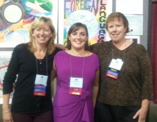 Nicole Sherf with MA Teacher of the Year, Kathleen Turner, a French teacher from Sharon, and MaFLA President Tiesa Graf, at the Advocacy Booth in the Exhibit Hall