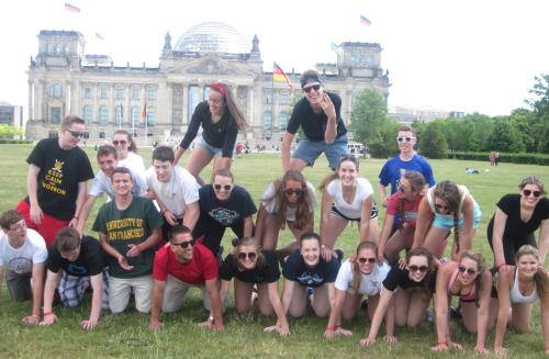 American students building a pyramid in front of the Reichstag, Berlin