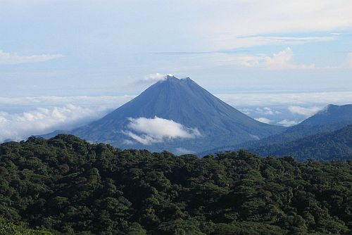 """""""Arenal Volcano as seen from Monteverde"""". Licensed under CC BY-SA 3.0 via Commons - https://commons.wikimedia.org/wiki/File:Arenal_Volcano_as_seen_from_Monteverde.jpg#/media/File:Arenal_Volcano_as_seen_from_Monteverde.jpg"""