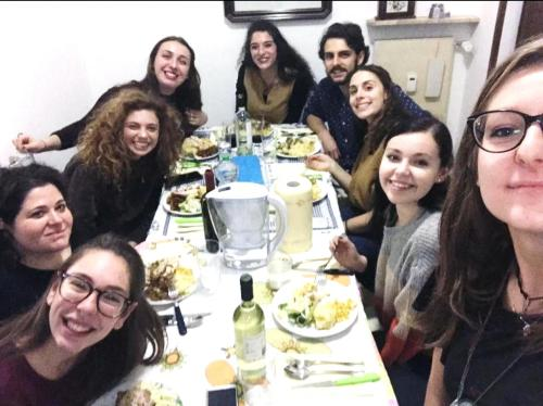 Samantha Sullivan (second on the right) and colleagues enjoy a meal in Italy